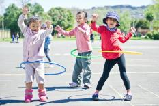 Young girls hula-hooping